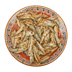 Fried sprats fish on a plate