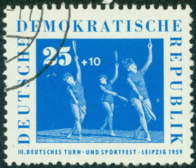 stamp printed in Germany shows Women's Gymnastics