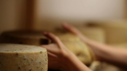 HD1080p: Close up of woman's hand moving cheese