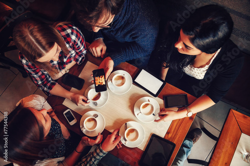 Friends In Cafe Drinking Coffee