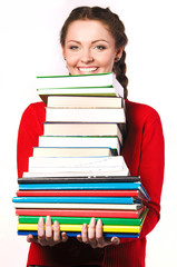 girl standing with a bunch of books