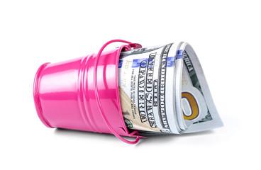 Money in a pink bucket