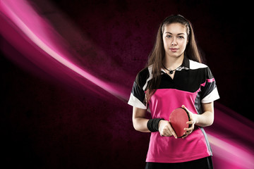 Portrait of Young Girl with Racket for ping-pong on pink