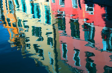reflection on the water of the colorful houses