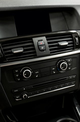 Car dashboard. Interior detail. Vertical photo.