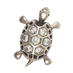 Silver turtle pendant with diamonds on a white background