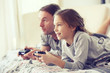 Child playing video game with father - 77550737