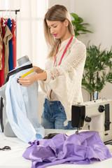Fashion Designer Takes Measure