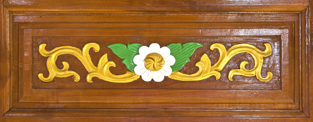 thai style of flower carv pattern on lacquer wooden door