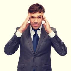 stressed buisnessman or teacher having headache