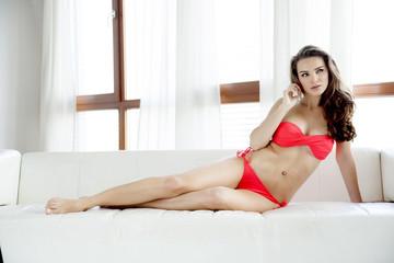 Beautiful and sexy woman in red bikini