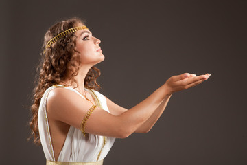 Classical Greek Goddess in Tunic Carrying Something on her Hands