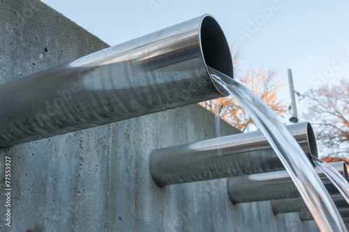 Water flowing out from steel pipes - 77553927