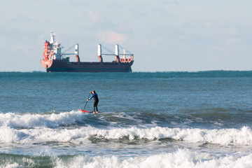 Stand up paddle board, surfer man paddleboarding