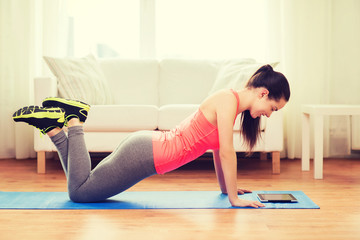 smiling teenage girl doing push-ups at home