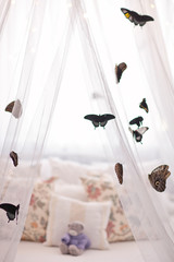 Beautiful tropical butterflies on white canopy. Sleep mood.