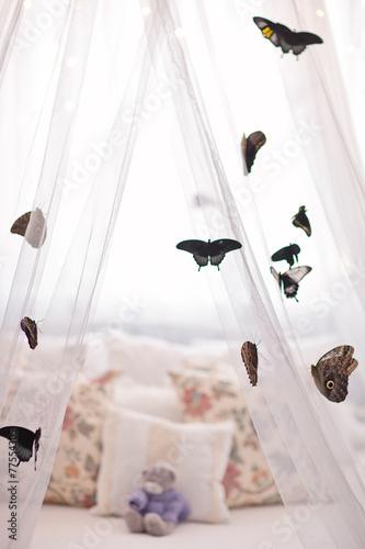 Beautiful tropical butterflies on white canopy. Sleep mood. - 77554305