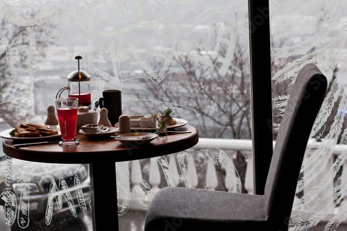 Breakfast for two in the cozy cafe on winter snowing morning. Ch - 77554997
