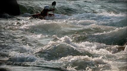 Ahot of kayaker blazing through white waters