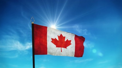 flag of Canada waving over sunny blue sky with some clouds
