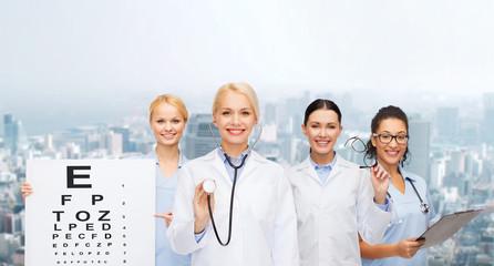 smiling female eye doctors and nurses
