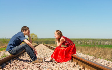 Couple sits on railway