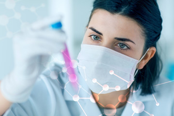 close up of scientist with tube making test in lab