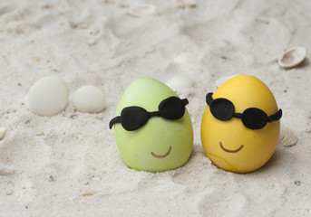 Couple easter eggs with sunglasses