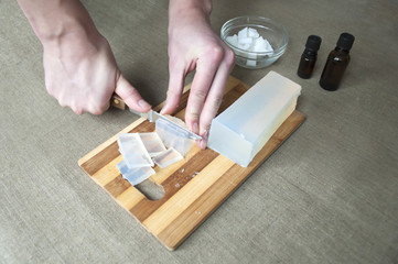 Hands cutting the soap - 2