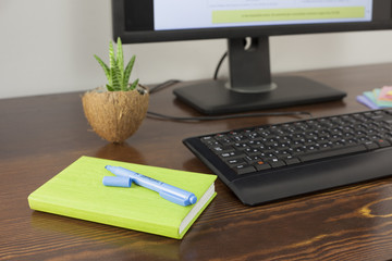notebook on wooden office table