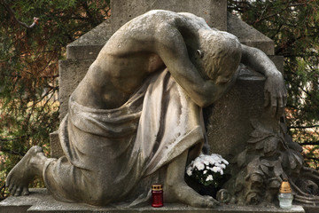 Mourning nude man. Old tombstone at the Kerepesi Cemetery in Bud