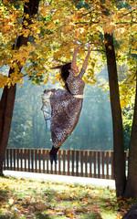 levitating girl in a leopard print dress