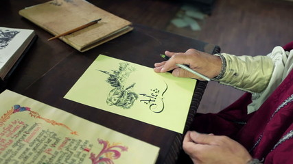 An old medieval scholar subscribing himself in calligraphic writing