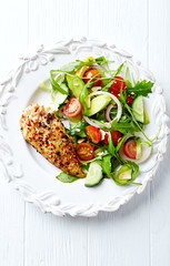 Grilled chicken fillet with colorful salad