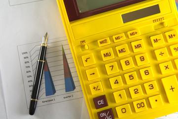 yellow calculator on table