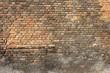 verwitterte Backsteinmauer als Hintergrundbild