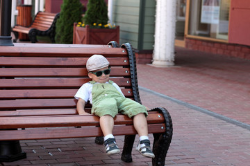 Boy resting on a bench