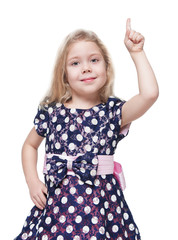 Beautiful little girl showing on something by finger isolated