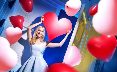 Cute cheerful lady among balloons