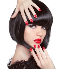 Beauty fashion brunette model portrait. Manicured nails. Red lip
