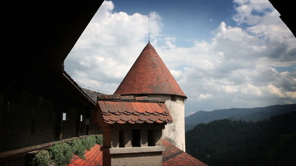 Shot of one part of Bled`s castle including tower and balcony