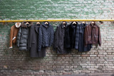 Men's trendy clothing on hangers