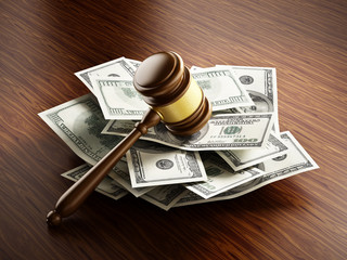 Judge gavel on 100 dollar paper money pile