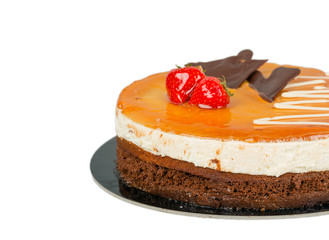 Chocolate cake with caramel on top isolated