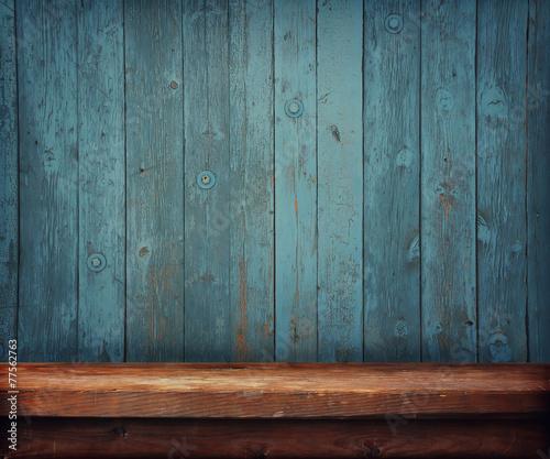 деревянный стол на фоне стены из досок poster