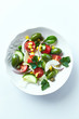 Mediterranean-style salad with whole green olives