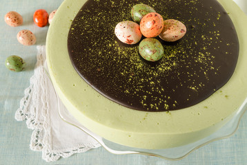Easter cake with tea matcha decorated sweet-stuff eggs