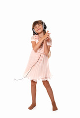 cute little girl singing into a microphone
