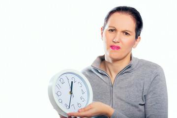 Woman setting clock at daylight savings time.