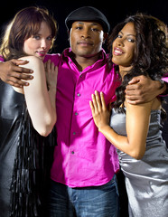charming single man with two women at a nightclub